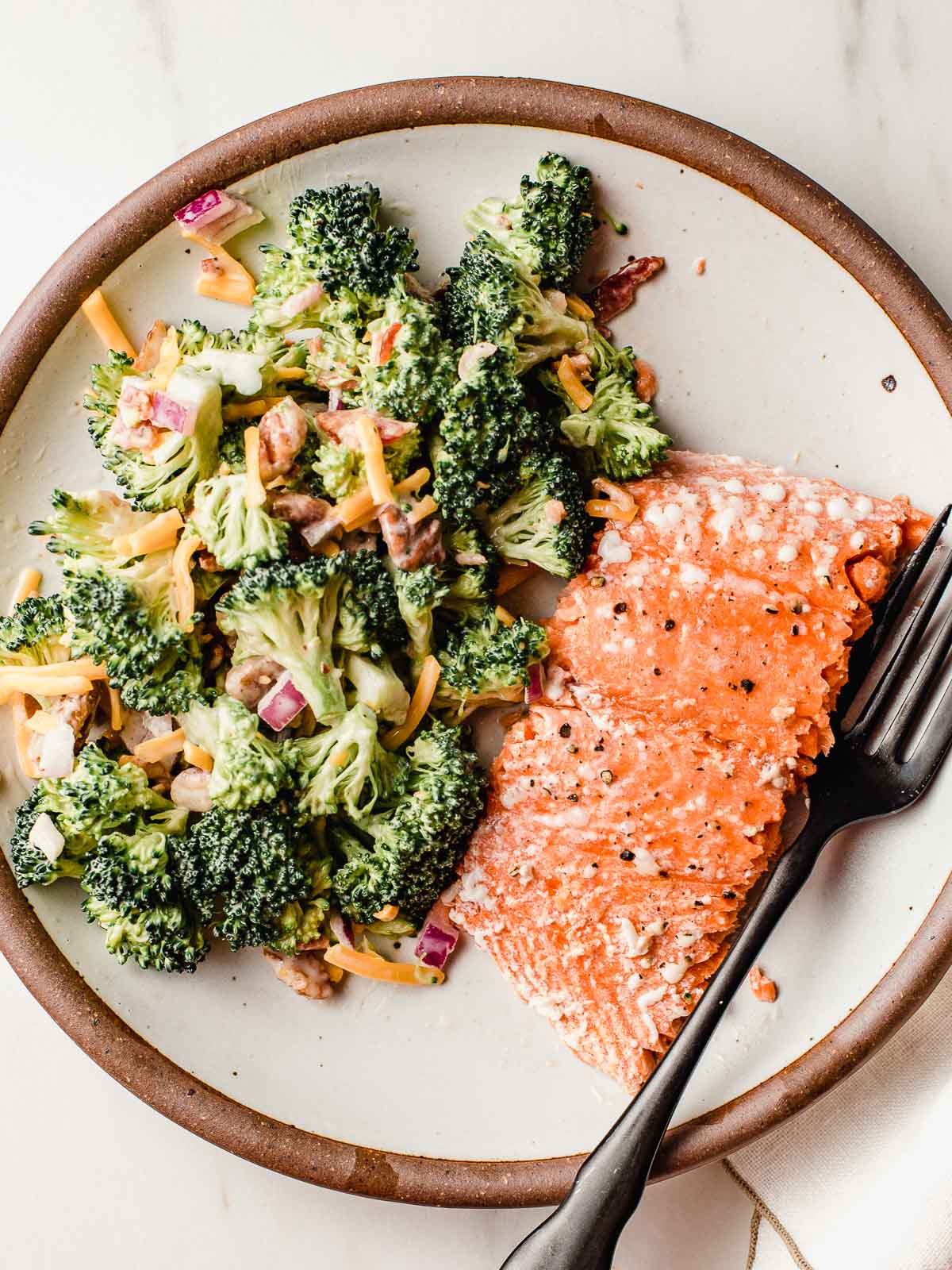 Baked salmon with broccoli salad on the side.