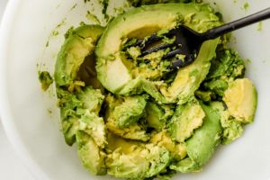 Mashed avocado in a bowl.