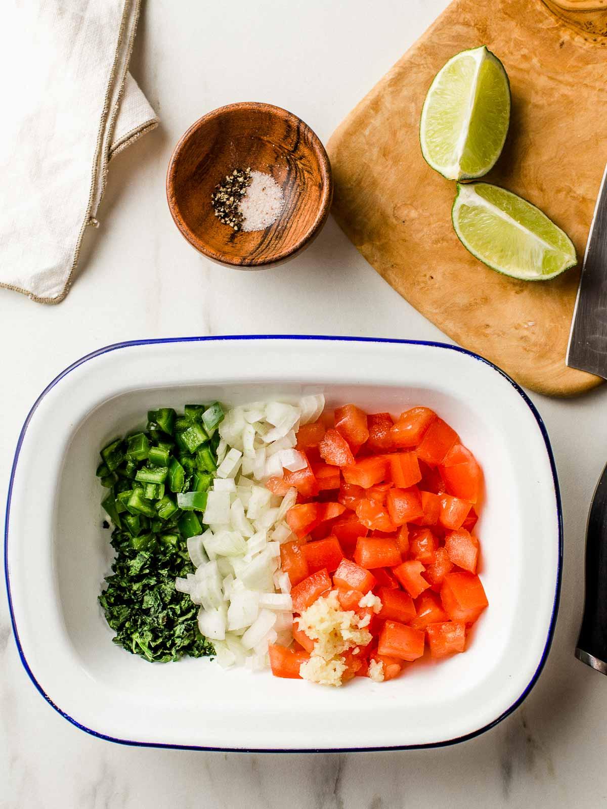 Guacamole veggies chopped in a bowl.
