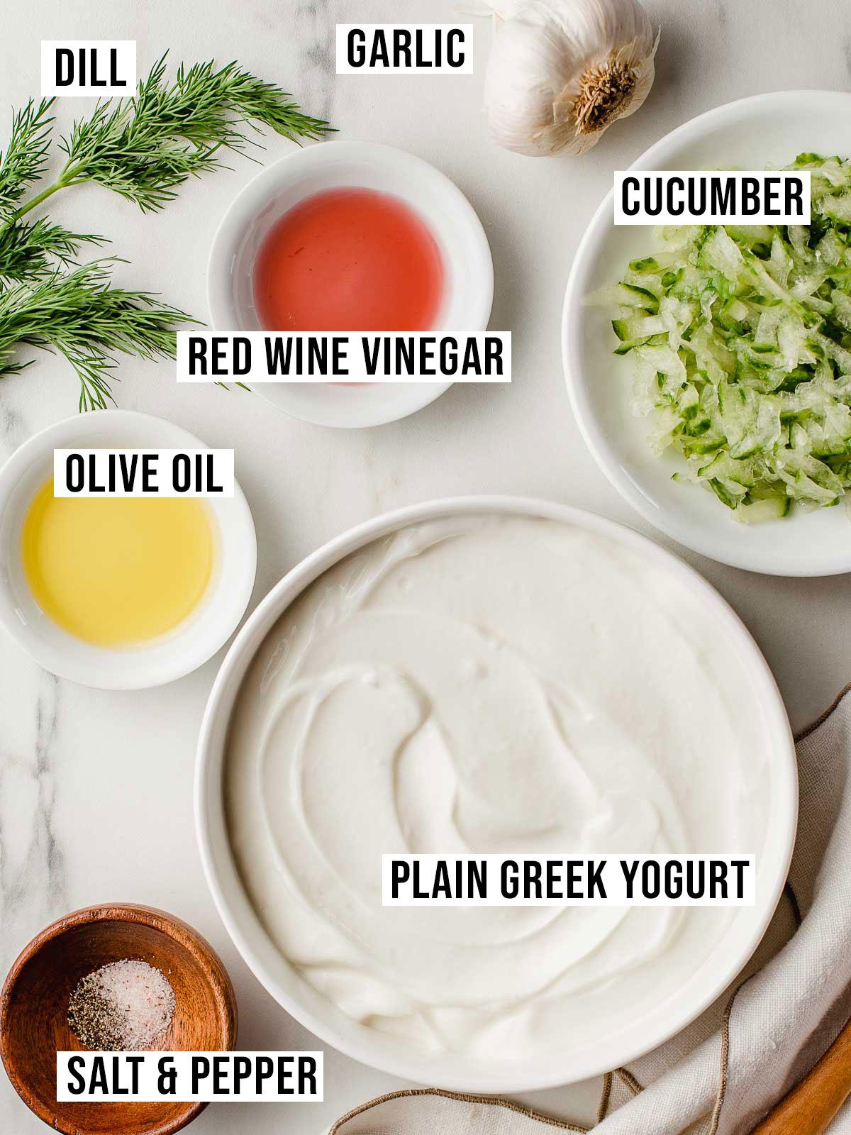 Tzatziki recipe ingredients on a table.